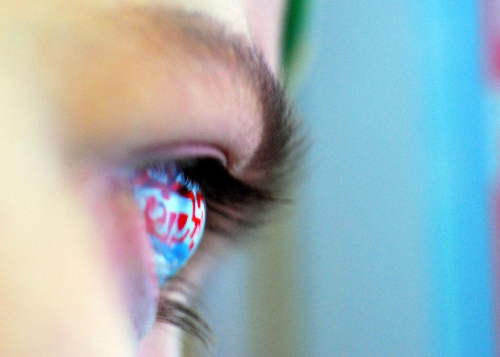 woman's eye starting at a promotional retail sign to convey the concept of eye tracking and digital signage