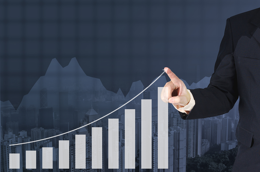 business man in suit drawing an upward line over a bar chart that is showing how value added reseller sales will grow once the right strategy is in place