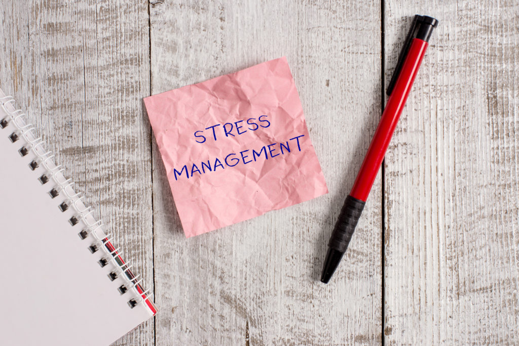 Writing pink sticky note showing the words Stress Management. Business photo showcasing concept of managing stress as a small business owner.